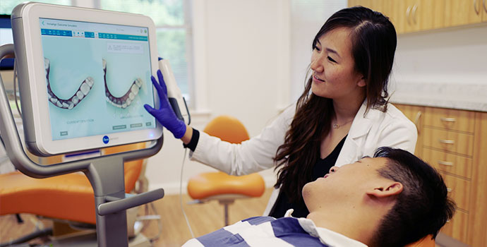 iTero, 3D scan, invisalign, treatment simulation, orthodontics, smiling dentist, technology, tech-savvy