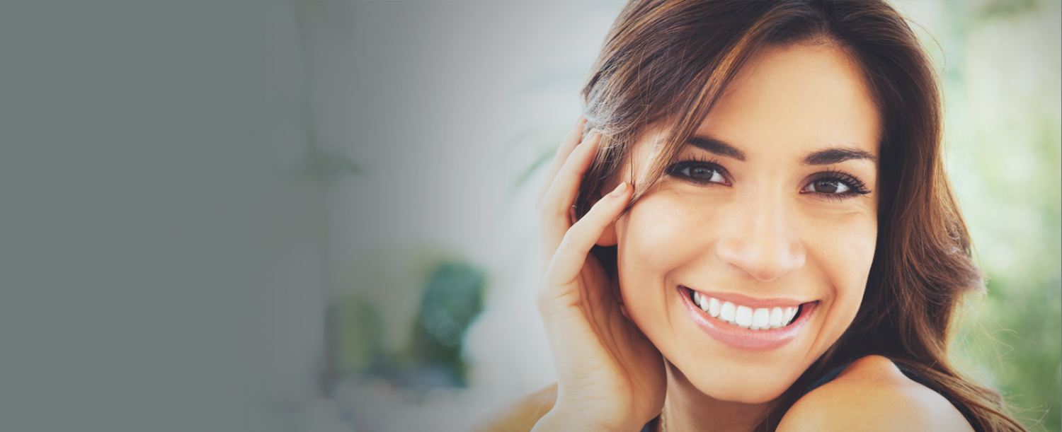 Beautiful woman, great smile, straight and white teeth, treated by invisalign